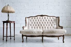 white genuine leather classical style sofa in vintage room with