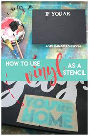 using vinyl as a stencil a and a glue gun