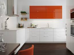 ikea white kitchen cabinet doors a medium sized kitchen with orange high gloss doors combined