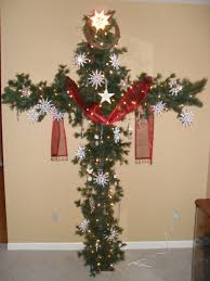 a cross christmas tree made from pcv pipe and garland red sash