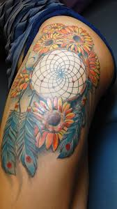 lovely dream catcher tattoo on forearm photos pictures and