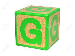 letter g on green wooden childrens alphabet block isolated on