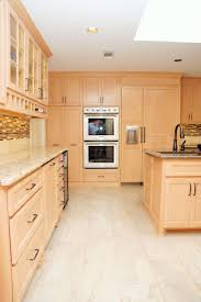 light maple cabinets stainless steel appliances tan and brown