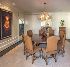 dining room with round table and antler chandelier rustic