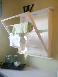 wall mounted drying rack for laundry 10 clever storage ideas for your tiny laundry room hgtv u0027s small