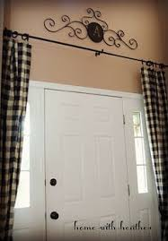 curtains over windows by front door or to mimic sidelights if you