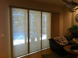 triple sliding glass doors with cream transparent curtains placed