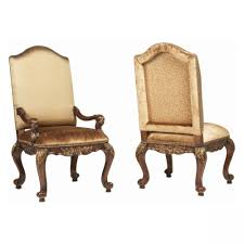 brown wooden carving armchair plus golden seat and back placed on