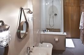 Vintage Style Vanity Lighting Majestic Industrial Style Bathroom With Clear Glass Sink Featuring