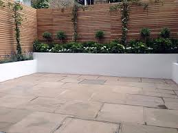 paving a patio raised garden fence with privacy raised garden bed