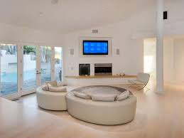 tv light wood floor sofa fireplace white column contemporary