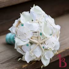 wedding bouquets with seashells seashell wedding bouquet starfish sand dollars all white orchid