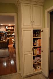 small kitchen layout and white stained oak wood narrow pantry