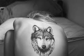 modern wolf on back tattoomagz