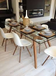 dining room with glass table top and plastic chairs featured dowel