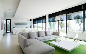 Comfortable Homes Interior Fabulous Beige Sofas And Ottoman On Wide Carpet For