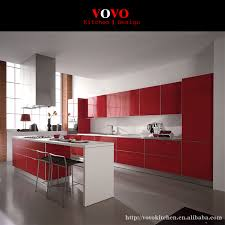 white kitchen with red walls island is white with drop down