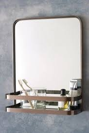Mirror With Shelves by Feehan Mirror By Egg Collective Arched Mirror With Brass Shelf