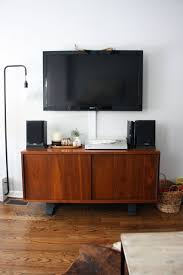 Cord Hiders For Wall Mounted Tv How To Hide Unsightly Electronics And Cords The Everygirl