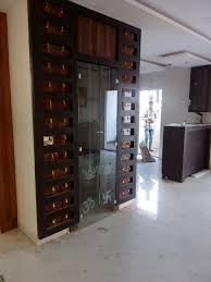 puja room glass door with bells best suit for flats puja room