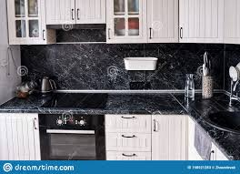 black kitchen cabinets with marble countertops modern kitchen is white with a black marble countertop