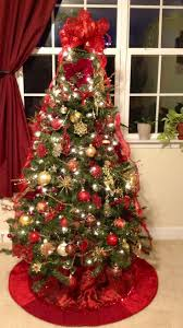 White Christmas Tree With Red And Gold Decorations White Christmas Tree With Red And Gold Decorations