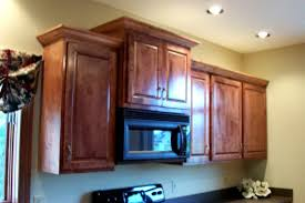 recent upper cabinets adjacent to a microwave kitchen