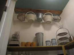 Small Storage Room Design - decorations small pantry room design with coat hooks and round