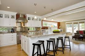modern kitchen island with seating black chairs and wooden floor