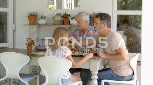 Same Sex Family At Home Eating Meal On Outdoor Verandah  Clip - Family sex room