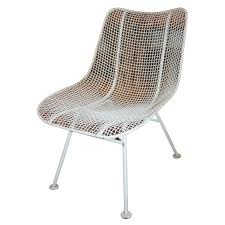 two dozen jet age wire mesh outdoor chairs by woodard for sale at