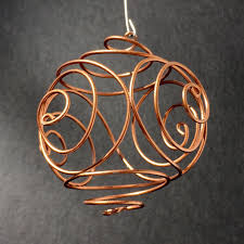 handmade wire ornaments in copper silver and gold