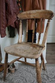 rustic chair and new rug in the entryway mrs rollman blog