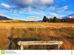 the wooden bench by the side of the road stock photo image 74604291