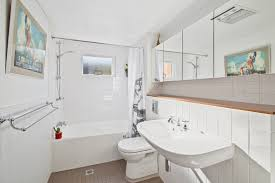 recent projects cs interior design a clever redesign in the bathroom placed the shower over the bath and introduced a hidden