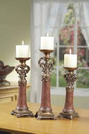antique pillar candle holder with beautiful ornament wellhouzz