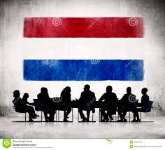 business people in meeting with flag of netherlands stock photo