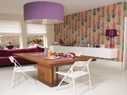 wallpaper on accent wall wine glass rustic dining table