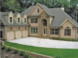 eplans house plan a two story stone entrance sets off the brick