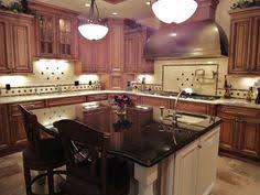 matching woodwork to baltic brown granite painting ideas with