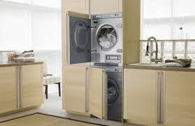 interior sleek laundry room idea with white fiberboard cabinetry