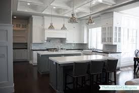 pine wood black glass panel door kitchen with 2 islands backsplash