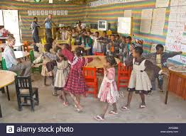 children playing a game in the classroom of a charity run