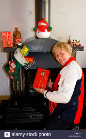 what to get an elderly woman for christmas elderly woman happy with presents stock photo 59263881 alamy