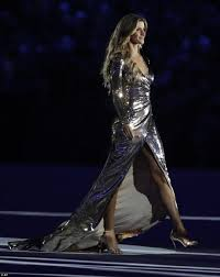 gisele bundchen proudly commands the stage in shimmery low cut