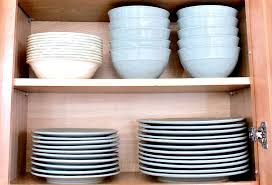 how do you arrange dishes in kitchen cabinets kitchen cabinet organization tips ideas and inspiration
