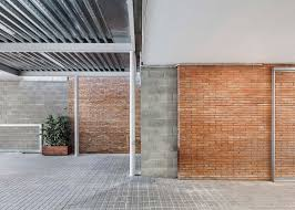 h arquitectes upgrades 1950s building with new facade
