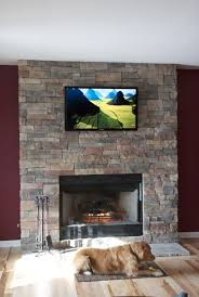 interior unique corner stone veneer fireplace with thick wood