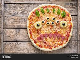 halloween background eyes halloween creative scary food monster zombie face with eyes pizza