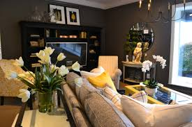 ethan allen design center featuring a black gray and yellow color